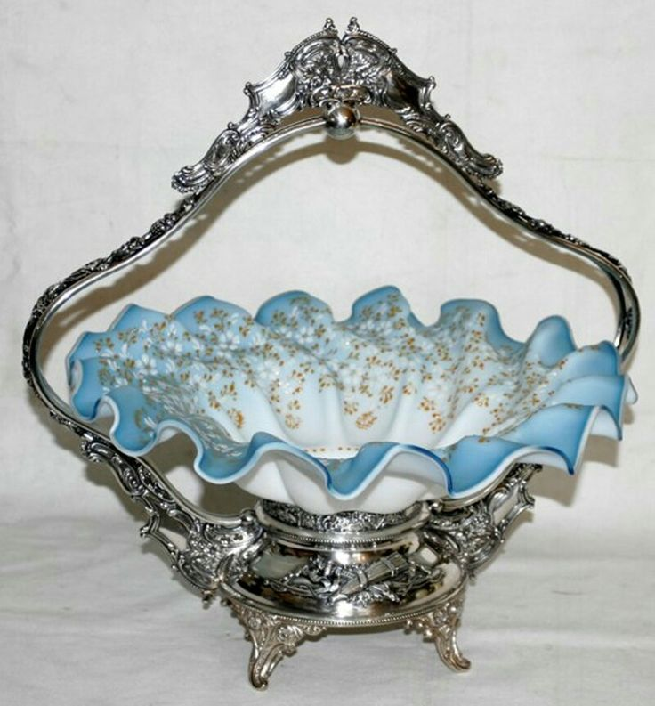 """VICTORIAN SATIN GLASS & MERIDIAN SILVERPLATE BRIDE'S BASKET, C. 1880, H 17"""", W 16"""":Light blue satin glass with enameled floral decoration raised on a fancy silverplate frame."""