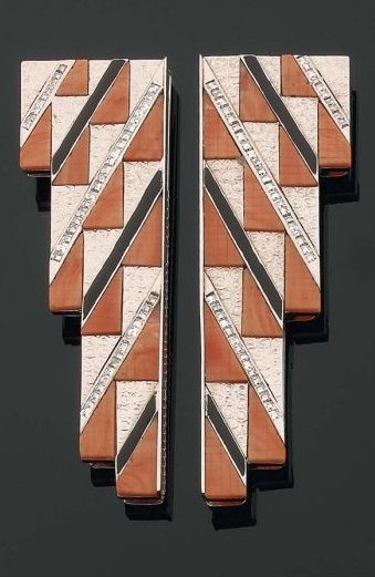 Art Deco dress clips, accented with coral plates and square diamonds and black enamel, set in 18k white gold, circa 1930s. #ArtDeco #DressClips