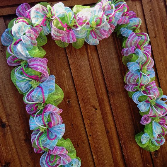 Spring garland, deco mesh garland, easter garland, deco mesh wreath, Spring into Easter garland, custom handmade gifts  Made to order! This piece is great for anything from centerpiece to full door decoration or a staircase! Mesh garland base is adorned with 2 mesh ribbons, deco tubing and glittered wire. Some subtle changes, mainly white glittered rope, may be made depending on availability and/or date needed. You can add decorations to the piece, such as ribbons and bows, if needed. Co...