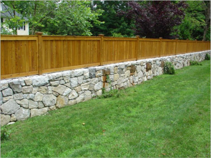 Westchester granite fieldstone retaining wall with cedar