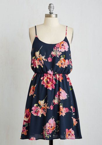 As you bathe in the sun's warmth, the rays showcase the beauty of your flirty floral sundress! With pink, orange, and white, watercolor-inspired blooms bursting atop a navy base - and complete with a horizontal back strap detail - this bright A-line exudes chic radiance.