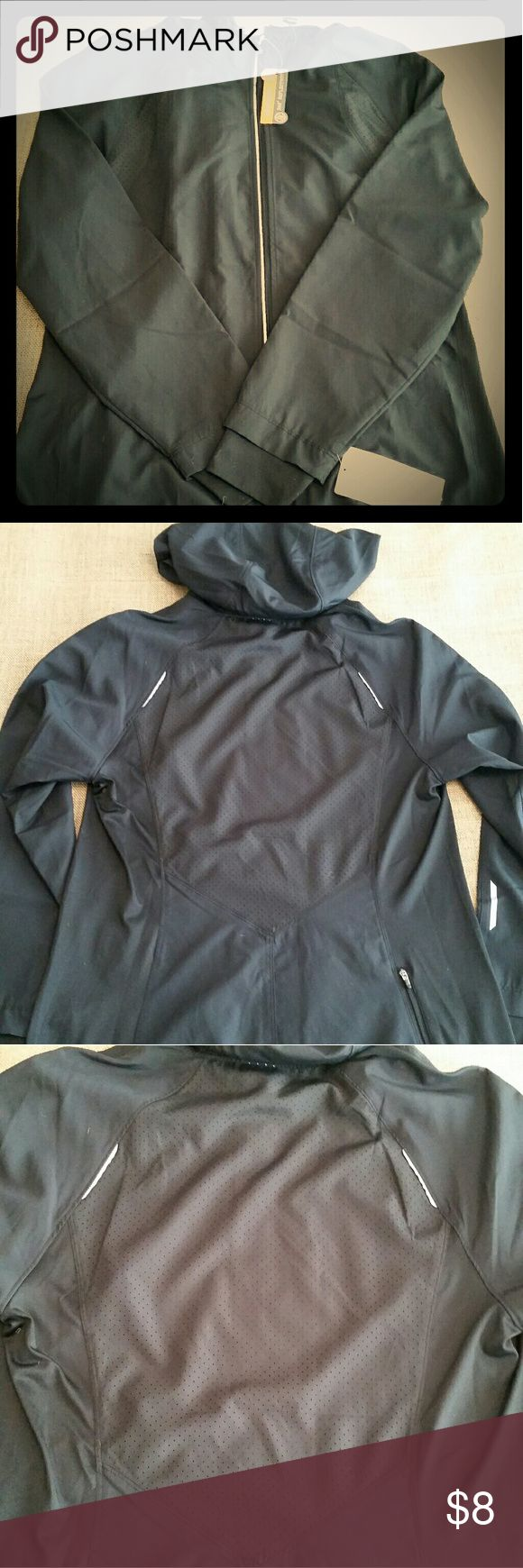 Champion Light Hooded Jacket This black size Large ladies light jacket is perfect for spring or an early morning workout. More of a windbreaker than a jacket. Has hood and a cool vented back. Brand new with tags. Sleeves feature those finger holes too...this is great for working out. The gray is reflective to keep you safe and there is also a zipper pocket on the rear bottom for easy cell phone storage. Champion Tops Sweatshirts & Hoodies