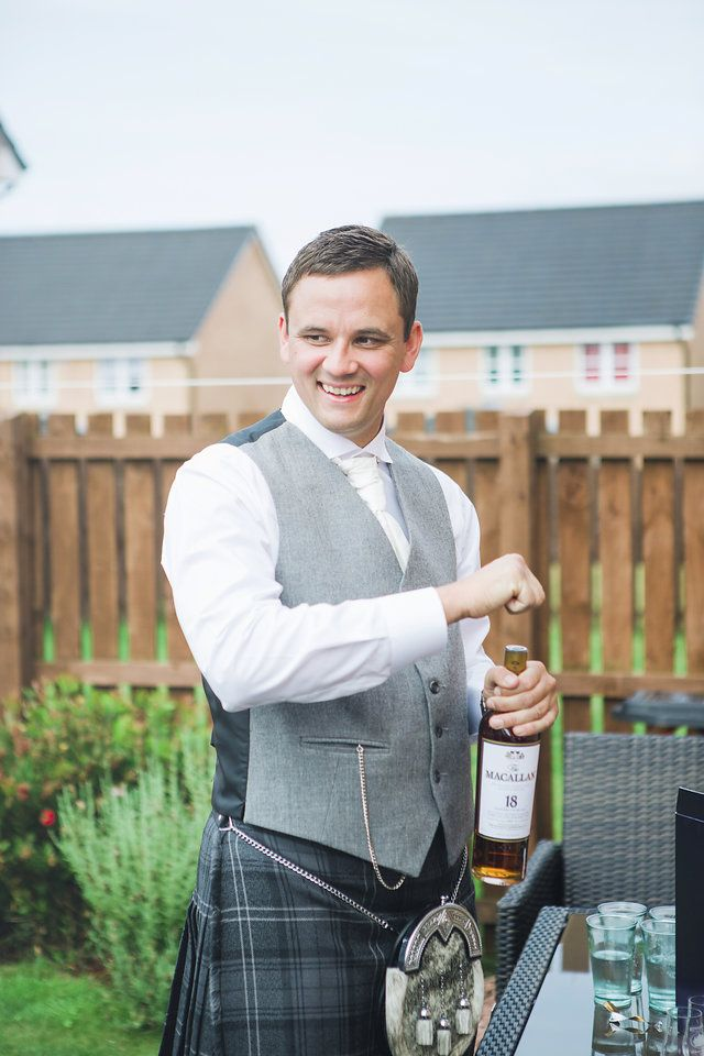 Groom Prep // The Gibsons Photography // wedding photographers Scotland // fine art wedding photographers // natural wedding photographers // creative wedding photographers // weddings Scotland // Scotland wedding // Destination Wedding Photographers // farm wedding // Dalduff farm wedding // groom // kilt // tartan // whiskey