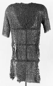 Iron Age. Chain mail of thousands of small iron rings marks a first peak in the European iron technology, as developed in the Celtic armories around 300 BC.  Chain mail was taken used by the Romans throughout the Iron Age and was a popular armour among leading warriors. The best-preserved Iron Age chain mail, seen here comes from Funen in Denmark and is dated to ca. 200 AD.