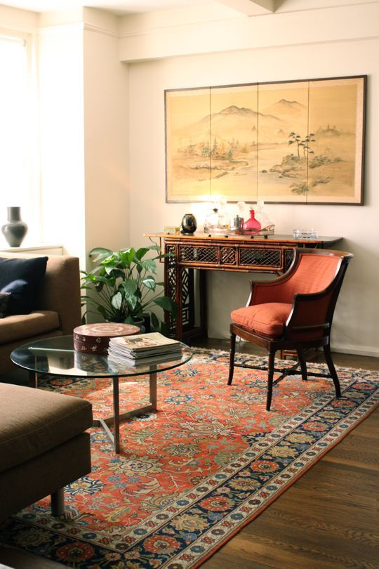 love how chinese desk and painting fits in so beautiful. simple but gorgeously hued furniture. great coffee table and perfectly matched rug.