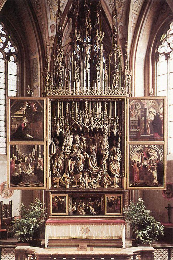 Michael Pacher,Altare di Sankt Wolfgang, 1471-1480,Sankt Wolfgang (Austria), chiesa parrocchiale. Audaci scorci prospettici, drammatica passionalità, dinamica articolazione delle composizioni, realismo corposo delle figure, sontuose stesure cromatiche sono le caratteristiche del fare artistico di Pacher, sia in pittura che in scultura. Nelle tavole dipinte il ritmo spezzato e marcatamente espressivo che caratterizza gli elementi plastici dell'altare si stempera in una visione più pacata e…