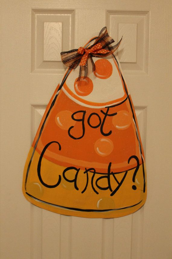 What better way to welcome Fall or to say Happy Halloween than with this aDOORable, wooden candy corn door hanger hanging on your front door or wall! It measures approx. 24 tall and 17 wide and is super light, weighing less than 2 pounds. This one has Got Treats hand painted on the front, but the writing can be customized at no charge, just let me know what you would like yours to say! The piece is handpainted and includes a bow and has an attached hanging wire. Your door hanger will be…