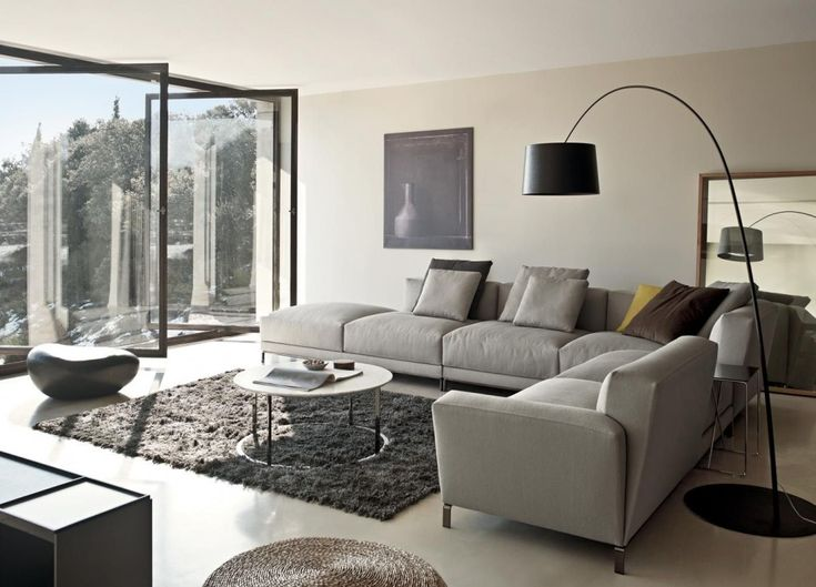 Gray Sectional Sofa Furniture With Round Table And Black Arch Lamp For Lighting