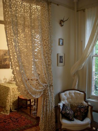 Lace Curtain...I could do this to my laundry room to replace the door.