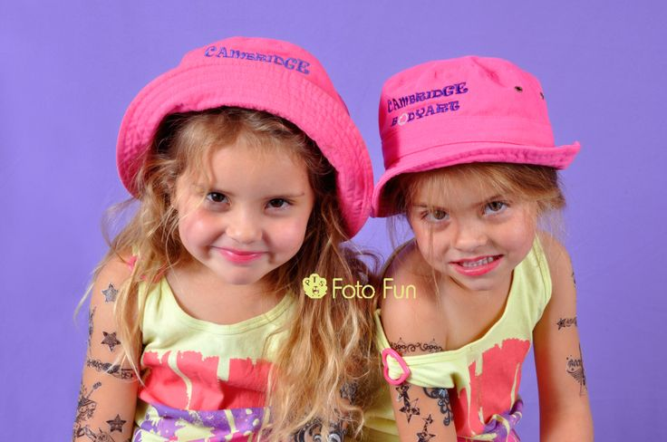 gorgeous twins with pink hats and tattooes