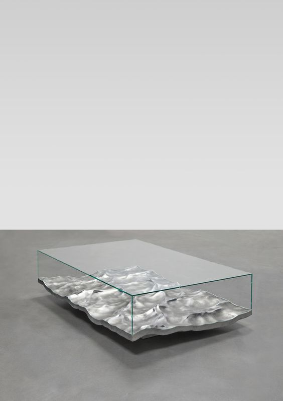 """""""They fix the moment as a frozen image and play with the constant reflections of light on their polished surface. Liquid creates a certain ambiguity of its materials, in a state of transition at the border of liquid and solid"""" - MATHIEU LEHANNEUR - (The """"Liquid Marble"""" table features convincing waves made from aluminium using 3D special effects software usually employed by the film industry. Design by Mathieu Lehanneur)"""