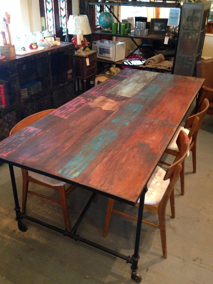 Love this dining table. Great colour on the old boards, Metal frame construction with casters www.nestinghabits.ca