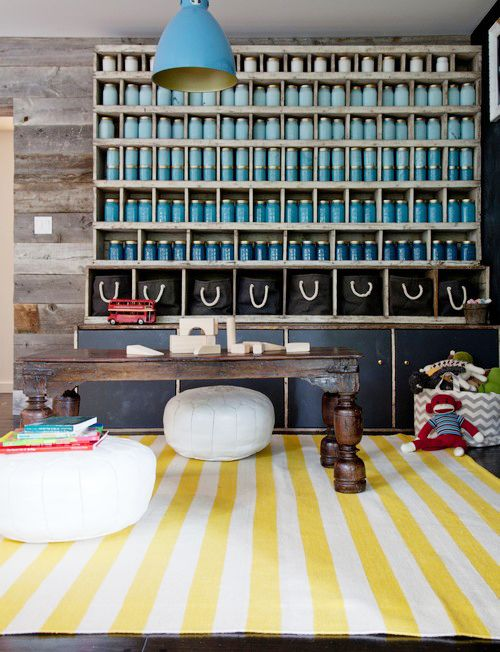 You'll Envy This Effortlessly Cool Family Home // blue bottle decor, white Moroccan poufs, yellow and white stripe rug, blue pendant light, wood walls: Playrooms Ideas, Olsen Design, Plays Rooms, Stripes Rugs, Studios Cities, Eric Olsen, Mason Jars, Kids Rooms, Accent Wall