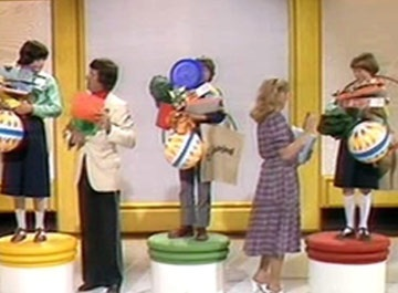 it's Friday, it's 5 o'clock, it's Crackerjack! Photo shows my favourite part of the show - quiz that included being loaded up with prizes and keeping what you didn't drop!