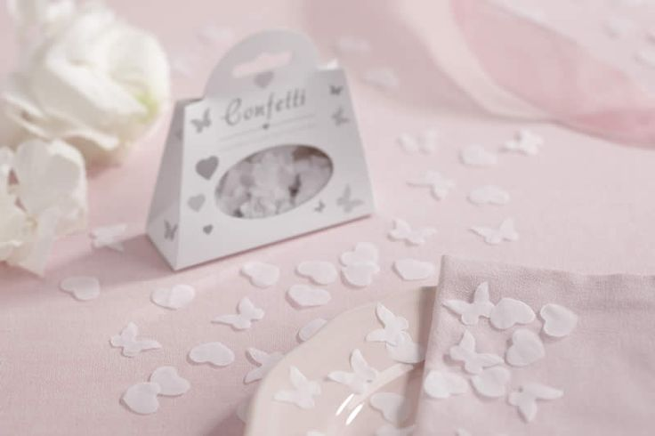 White biodegradable butterfly and heart shaped tissue paper confetti, perfect for outdoor events or table decoration. This pretty confetti comes in beautifully decorated individual boxes with approximately 7 grams or 4 handfuls of confetti.