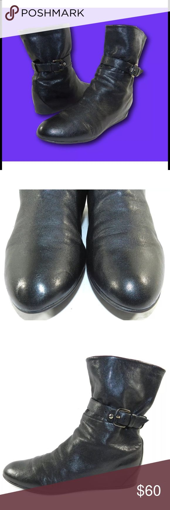 """STUART WEITZMAN Black Leather Wedge Ankle Boots Women's STUART WEITZMAN Black Leather Buckled Wedge Ankle Boots Booties      Classic black leather wedge ankle boots by Stuart Weitzman.   Sz 8.5 M.  Bottom of soles measure approx. 10 1/4"""" long and 3 1/4"""" wide at widest part.    9"""" shaft height.    Good pre-owned condition.  Signs of wear include some scuff/scratches and wear to soles.  Please see all photos for further indication of wear and condition. Stuart Weitzman Shoes Ankle Boots…"""