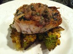 How to get a perfect golden crust on fish! Cooking tips are part of this recipe for herb-crusted corvina with shallot-caper sauce and romanesco.