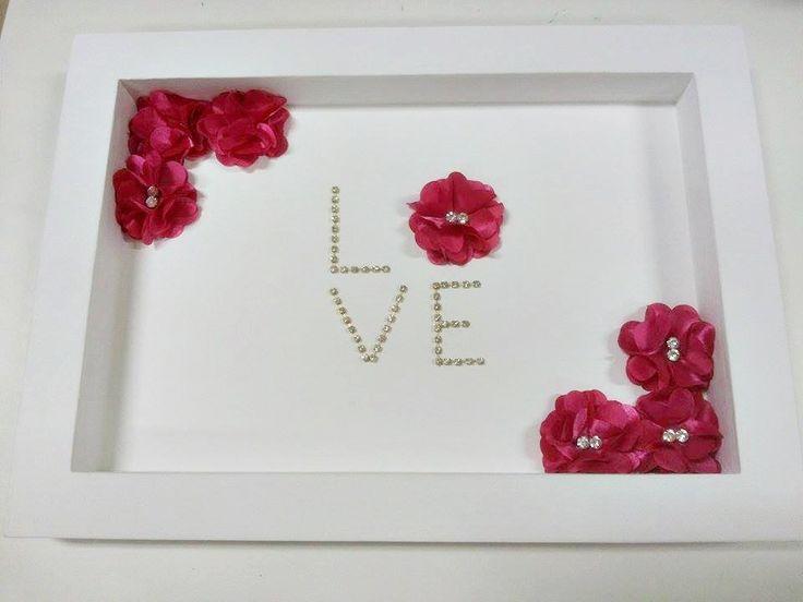 Quadro com flores de tecido