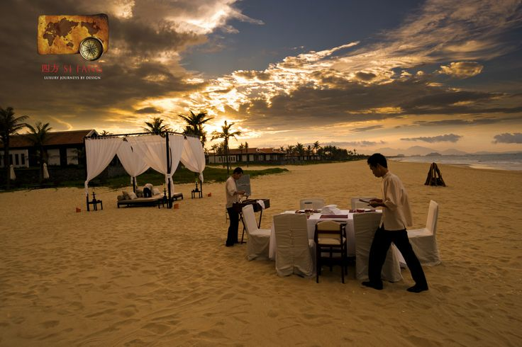 Setting up a private dinner for a group of friends, on the beach at the Nam Hai Resort near Hoi An in Vietnam.