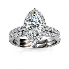 Marquise Halo Diamond Engagement Ring Wedding Set - A piece full of beautiful stones in a unique style with this 950 Platinum Marquise Halo Diamond Engagement Ring Wedding Set placed in a Prong setting featuring a White Marquise cut center stone with 50 White Round cut accent stones on the Halo style shank & band. The Marquise Halo engagement set comes with an SI in clarity as well as a G-H in color. The gem weight is equal to .32 carats. The diamonds are 100% natural…