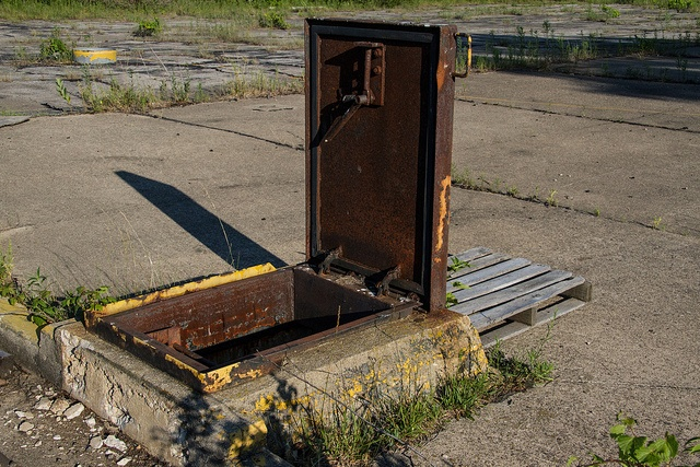 Rusty hatch to an Abandoned NIKE Missile Complex - Indiana. Just a few derelict buildings above ground, totally flooded underground.