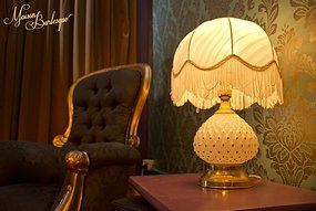 Maison Burlesque | Burlesque Boudoir and Studio based in Melbourne, Australia. Reburbished black & gold grandfather chair and 1950's lamp.