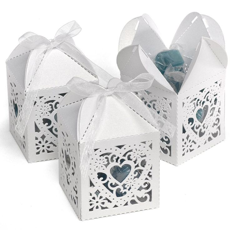 Charming wedding party die-cut heart shaped favor boxes ..get a sneak peek at what's inside through the ornate, die-cut design..Wedding Favor Boxes..Favor and gift boxes