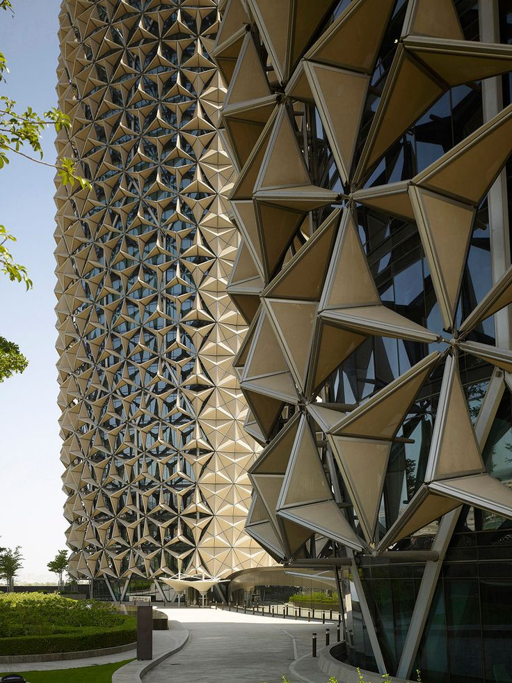 Al Bahr Tower Abu Dhabi - Dynamic Moving Facade Screen has an interactive relationship to the environment