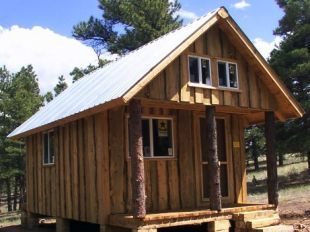 Cabin loft and tree trunks on pinterest for Board and batten cabin plans
