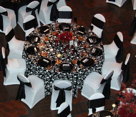Lovely White On Black Ribbon Taffeta Linens With White Spandex Chair  Covers Available For Rent From