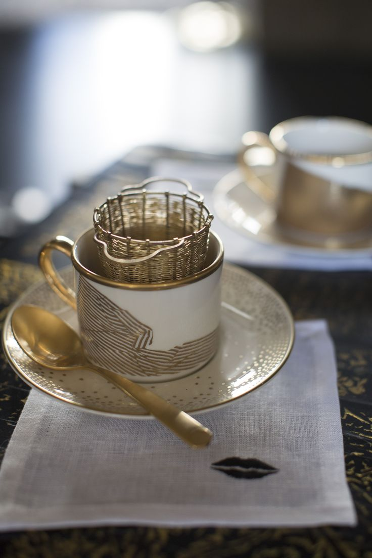 KELLY WEARSTLER | TEA CUPS & SAUCERS. Fine china with 22k gold detailing