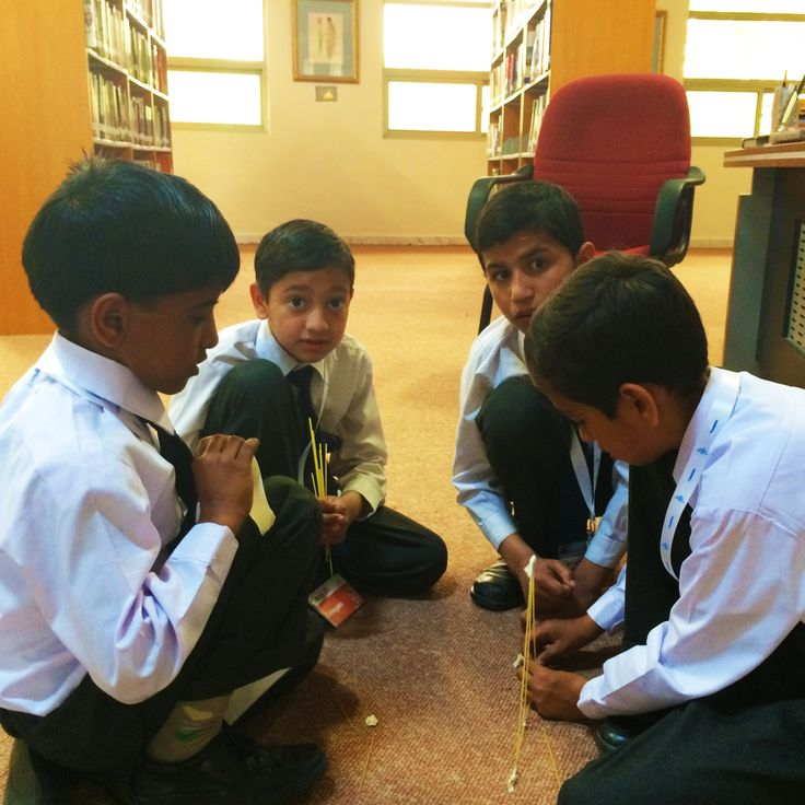 Children taking part in an activity in the library.