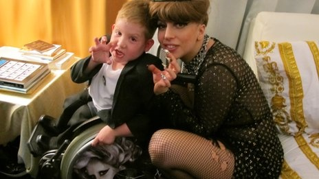 """Oran Murphy, from Newtownabbey, County Antrim, who has spina bifida, is a huge Lady Gaga fan.    The six year old has a specially adapted wheelchair which has a picture of Lady Gaga and the Born This Way logo on the wheels.    Lady Gaga was performing in Dublin as part of her Born This Way Ball world tour.    Oran said he was """"shaking"""" when he got to meet his idol."""