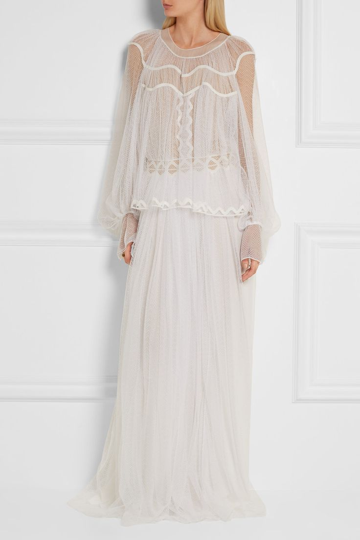 Chloé's gown is cut from swathes of wispy herringbone-patterned lace that falls to the floor, creating graceful movement as you walk. A standout look from the Pre Fall '16 collection and one of our favorites, it has a billowy babydoll overlay and is spliced with ric-rac embroidery to define your waist. We think it's a romantic choice for bohemian brides.  Shown here with: Chloé Sandals, Cornelia Webb Ring.