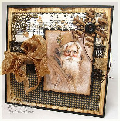 Black & Gold...Christmas card with sheet music paper, snowflake, vintage santa, &...bow.  Would make a lovely layout for a photo