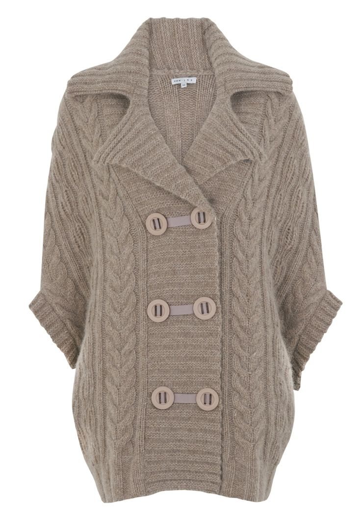 This chunky lambswool knit cape with military button detail is sure to keep you warm and cozy on those chilly fall evenings.  It's great to throw over a flowing dress and a pair of knee-high boots.