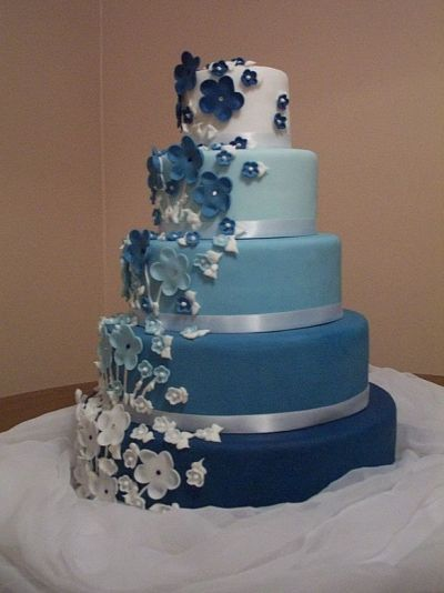 I love the varying shades of blue & beautiful flowers!!    First Fondant Wedding Cake By emf7701 on CakeCentral.com