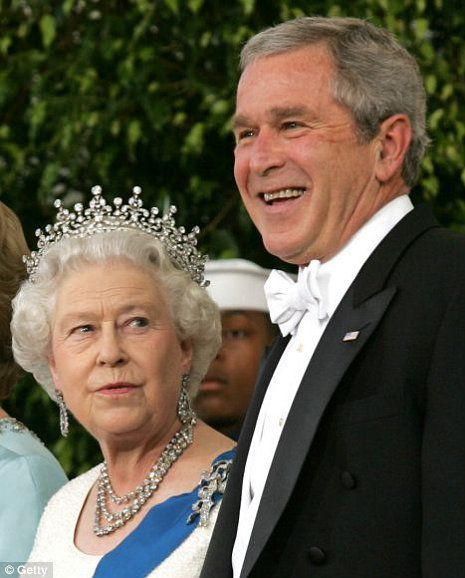 Queen Elizabeth II is greeted by US President George W. Bush on the North Portico of the White House upon arrival for a State Dinner 07 May 2006 in Washington, DC, the first white-tie and tails event of the six-year Bush presidency.