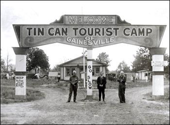 "Tin Can Tourists camp. Gainesville, Florida in the 1920's.  Signs read: ""Keep to the Right,"" ""Go Slow,"" and ""No Peddlers Allowed."""