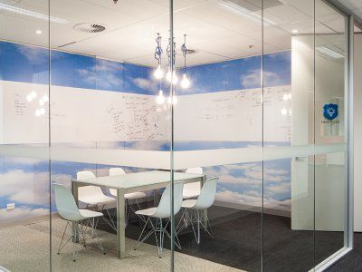 Open plan conference room with cool colours and vintage lighting.
