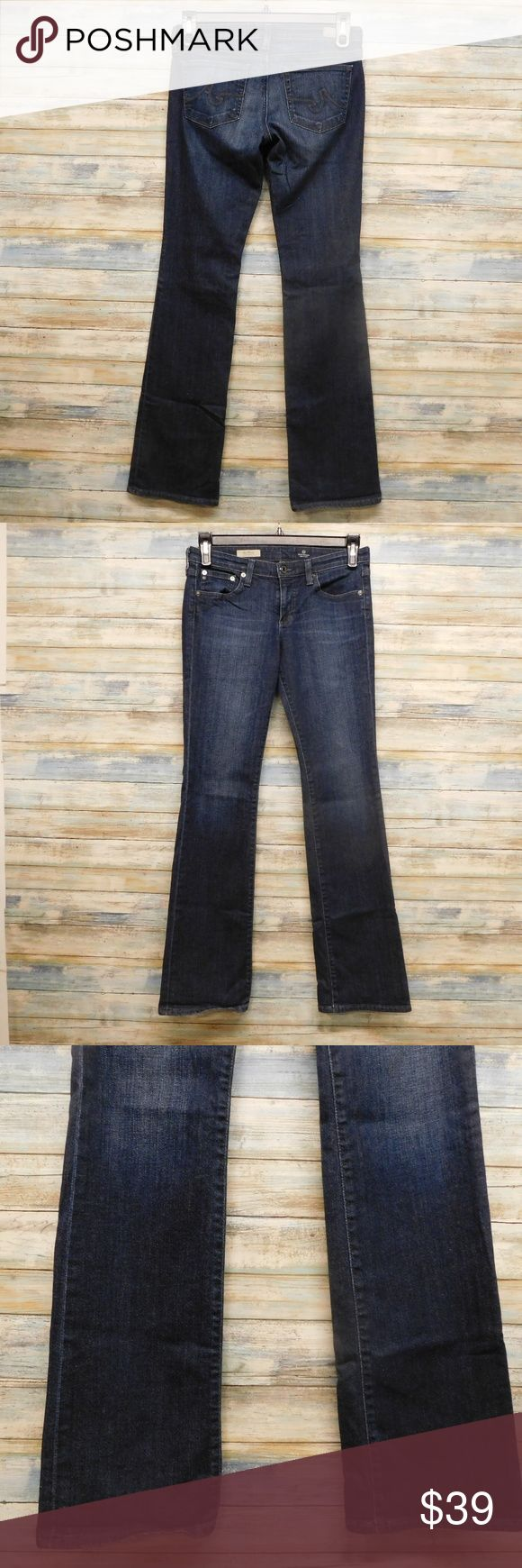"""AG Jean Women Olivia Skinny Boot cut Stretch 29x33 AG Jeans Women Olivia Skinny Boot cut Stretch Jeans 29 x 33""""       (B-38) color: dark blue  size 29R x 33"""" inseam   actual waist measures 31"""" Rise 8""""   Leg opening laying flat 8"""" style name: The Olivia 70% cotton  28% Lyocell    2% Polyurethane IN VERY GOOD CONDITION Ag Adriano Goldschmied Jeans Skinny"""