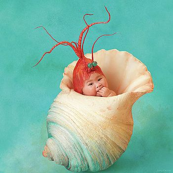 Anne Geddes - This photo is too cute. I love how she captures babies in a way that makes them believe they can be and do anything. Its not anything we would picture out of a baby picture but still just as cute.