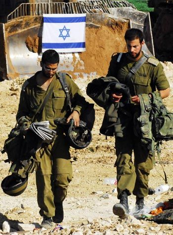~J    Wouldn't it be wonderful... if these young warriors could be studying instead of fighting....Israeli soldiers walk along Israel-Gaza border