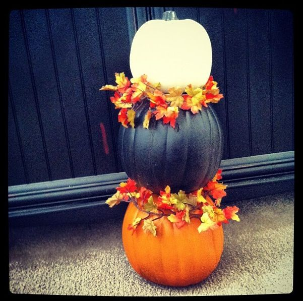 Pumpkins different sizes cut holes in first one and second one hot glue them together then add fall leaves to it perfect for front door look also put them in planters with fall leaves so they look taller and store bought not home made