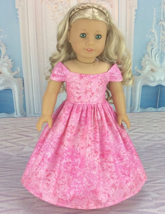 This 18 inch ball gown doll dress is made to fit american girl and similar sized dolls. This stunning off the shoulder ball gown style dress is made from Pink designer fabric that has touches of Silver shine all over it. I finished the gown with a lined bodice and rolled hem. These techniques do take more time, but they add a professional look to the garment and add to the durability. Gown closes in back with snag free velcro.  My doll and her shoes are not included. Please ask any questions…