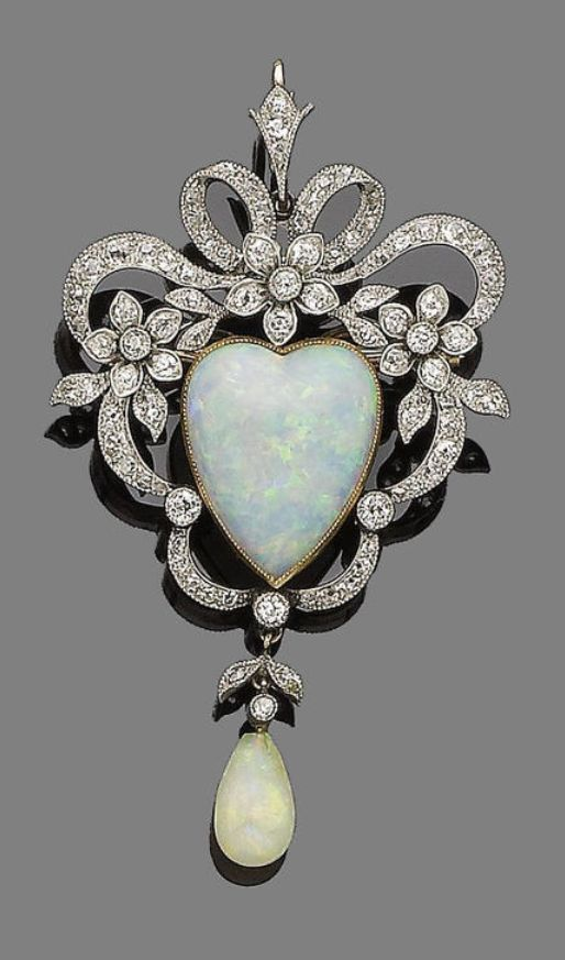 An opal and diamond brooch/pendant, circa 1890. The openwork cartouche of ribbon...
