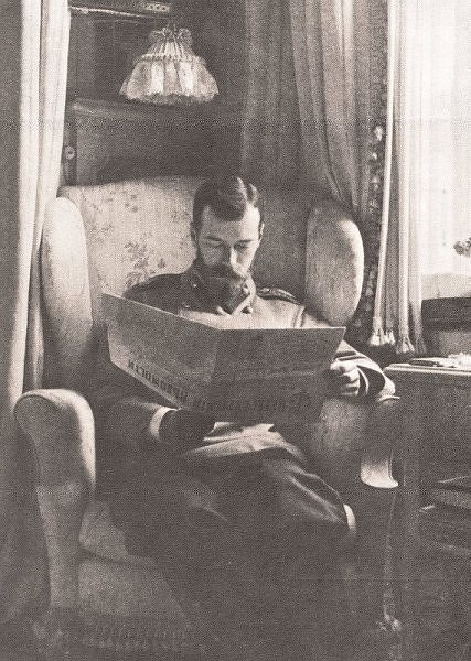 Tsar Nicholas II, reading the papers in the family's favorite wingback chair by the window.