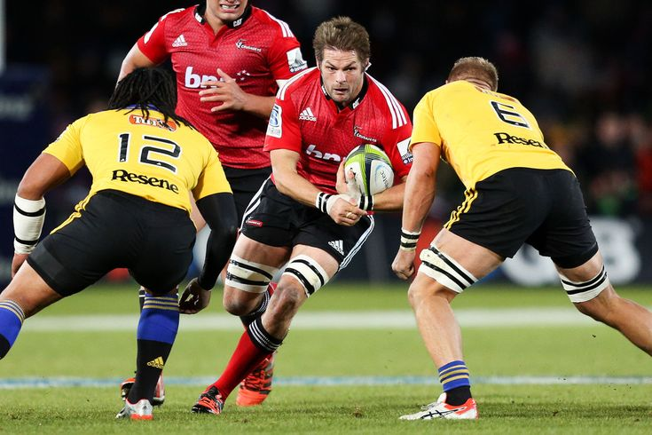 Richie Mccaw Photos Photos - Richie McCaw of the Crusaders runs at Ma'a Nonu (L) and Brad Shields of the Hurricanes during the round 16 Super Rugby match between the Crusaders and the Hurricanes at Trafalgar Park on May 29, 2015 in Nelson, New Zealand. - Super Rugby Rd 16 - Crusaders v Hurricanes