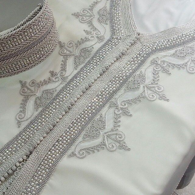 Fancy embroidery and embellishment on white fabric