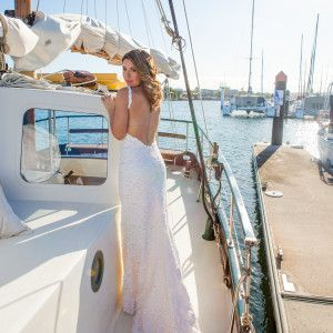 Stunning Styled shoot at Mooloolaba Yacht Club Photograhy by Benny Jewell Photography Dress by Elizabeth De Vargo Make up by Sally Townsend Hair: Rollingscissors